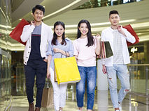 Two young asian couples in shopping mall Royalty Free Stock Image