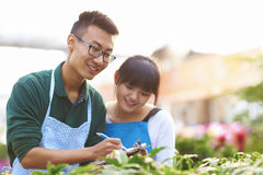 Two Young Asian Florist Working in the shop Stock Photo