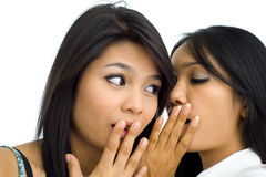 Two young asian friends gossip stock images