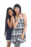 Two young asian girls. Two young asian women making fun of someone Stock Image