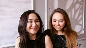 Two young asian girls models. Dolly shot stock video footage