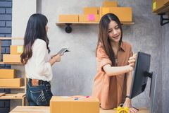 Two young Asian people startup small business entrepreneur SME d. Istribution warehouse with parcel mail box. small business owner home office. Online marketing Royalty Free Stock Photography