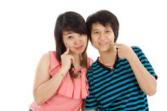 Two young asian women. Posing over white background Stock Images
