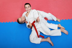 Two young athlete with a red and white belt show finger super Stock Photo