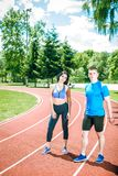 Two young athletes on track field. Stock Photo