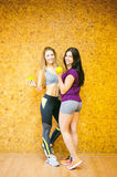 Two young athletic physique women in gym Stock Image