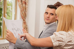 Two young attractive architects discussing design Stock Photo