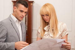 Two young attractive architects discussing design Stock Images