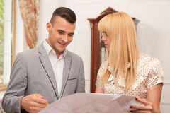 Two young attractive architects discussing design Royalty Free Stock Image