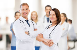 Two young attractive doctors. Healthcare and medical concept - picture of two young attractive doctors Royalty Free Stock Photos