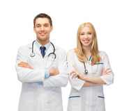 Two young attractive doctors. Bright picture of two young attractive doctors Stock Image