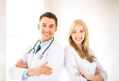 Two young attractive doctors. Bright picture of two young attractive doctors Stock Images