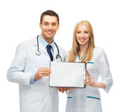 Two young attractive doctors. Bright picture of two young attractive doctors Royalty Free Stock Image