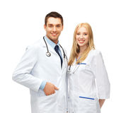 Two young attractive doctors. Healthcare and medical concept - picture of two young attractive doctors Stock Image