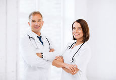 Two young attractive doctors. Healthcare and medical concept - picture of two young attractive doctors Stock Images