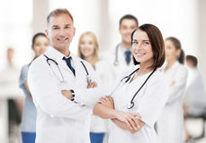 Two young attractive doctors Stock Photos