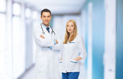 Two young attractive doctors in medical facility Stock Photography