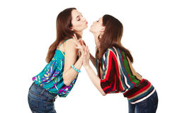 Two young attractive girls kissing. Isolated on white Royalty Free Stock Photos