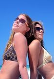 Two young attractive women chilling in the sun on holiday or vac Royalty Free Stock Photo
