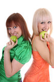 Two young attractive women with green apples Stock Photography