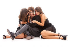 Two young attractive women kissing man Stock Image