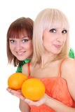 Two young attractive women with oranges Stock Photography