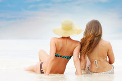 Two young attractive women on sea background Stock Photo