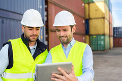 Two young attractives dockers working on the dock Stock Photo