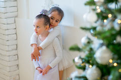 Two young ballet dancer hug near Christmas tree Royalty Free Stock Images