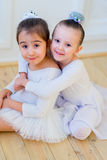 Two young ballet dancers hug Stock Photography