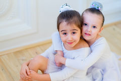 Two young ballet dancers hug Stock Image