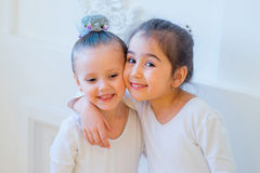 Two young ballet dancers hug Stock Images