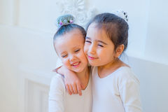 Two young ballet dancers hug Royalty Free Stock Images