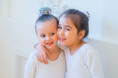 Two young ballet dancers hug Stock Photo