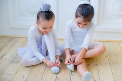 Two young ballet dancers preparing for lesson royalty free stock images