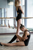 Two young ballet dancers in the studio during the Stock Images