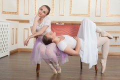 Two young beautiful ballet dancers sitting on sofa Royalty Free Stock Photography