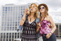 Two young beautiful blonde hipster girls on summer day having fu Stock Images