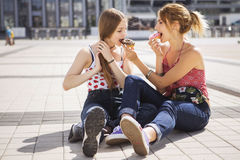 Two young beautiful blonde hipster girls on summer day having fu Stock Photo