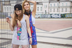Two young beautiful blonde hipster girls on summer day having fu Stock Image