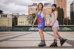Two young beautiful blonde hipster girls on summer day having fu Royalty Free Stock Images