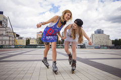 Two young beautiful blonde hipster girls on summer day having fu Stock Photos