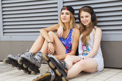 Two young beautiful blonde hipster girls on summer day having fu Stock Photography
