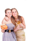 Two young beautiful blonde women celebrating Royalty Free Stock Images