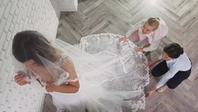 Two young beautiful brides trying her dress in shop. Wedding concept. Two young beautiful brides trying her dress in shop stock video footage