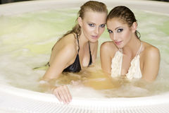 Two young beautiful girls in jacuzzi Royalty Free Stock Photo