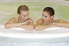 Two young beautiful girls in jacuzzi Stock Images