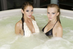 Two young beautiful girls in jacuzzi Royalty Free Stock Photos