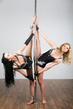 Two young beautiful dancer doing acrobatic tricks stock photos