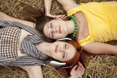 Two young beautiful girl at field. Royalty Free Stock Image